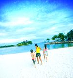 Lagoon beach family fun in tropics Royalty Free Stock Images