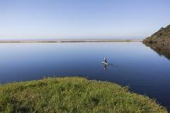 Lagoon Beach Paddler Solitude Royalty Free Stock Image