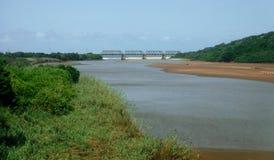 Lagoon bridge. A train bridge crosses a lagoon near Illovo on the KZN South coast Stock Photos
