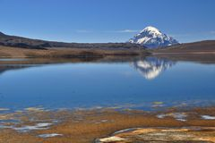 Lagoon Chungara. And a reflection of a volcanic cone in the National Park Lauca- north Chile Stock Photography