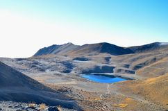 Lagoon in Crater at Toluca Volcano. Sun beams at sunrise at the high altitude lagoon at Toluca Volcano in Mexico.  Hiking trails take you down into the crater stock photo