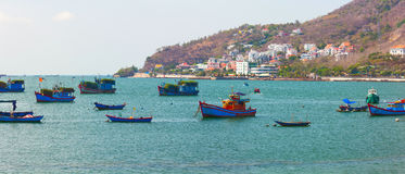 Lagoon with different fishing boats. Vung Tau, Vietnam. Royalty Free Stock Images