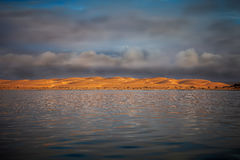 The lagoon and dunes Stock Images