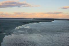 Lagoon landscape sunset mont saint-michel low tide water reflection sand pastel clouds twilight stock image
