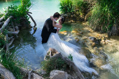 Lagoon of love. Couple in the water of a lagoon, showing great complicity royalty free stock images