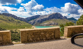 Lagoon in Mallorca mountains. Photograph of a view from a car window passing around lagoon in high mountains of Mallorca, Balearic Islands, Spain Royalty Free Stock Photo