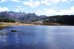 Lagoon in the middle of the mountain. A pond found amid trees and mountains water Royalty Free Stock Photo