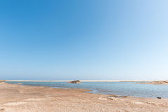 Lagoon at the mouth of the Huab River. The lagoon at the mouth of the Huab River on the C34-road between Henties Bay and Torra Bay in the Skeleton Coast area of Stock Photo