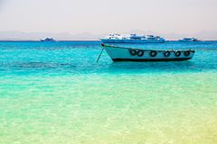 Turquise water of the exotic beach. Lagoon of the Red Sea at Mahmya island, Egypt Stock Images
