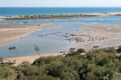 The lagoon of the Ria Formosa seen from the cliff of the village stock photos