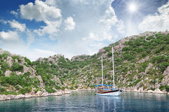 Lagoon, sailing ship and  coast Stock Image