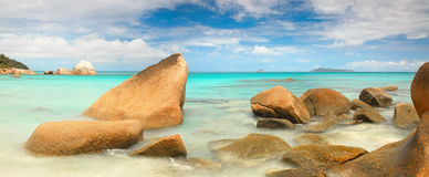 Lagoon with  stones and with a clear turquoise sea horizontal background Royalty Free Stock Images