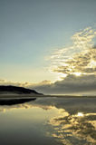Lagoon sunrise. Early morning reflection of the clouds on a still lagoon royalty free stock images