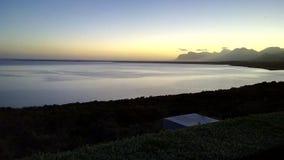 Lagoon. Sunset over lagoon facing mountain stock photo