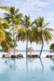 Lagoon with sunshades and sunbeds Royalty Free Stock Image