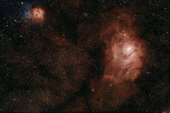 Lagoon and Trifid nebulae. In Sagittarius, also known as M8 and M20 respectively royalty free stock photography