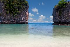 Lagoon with tropical beach Stock Images