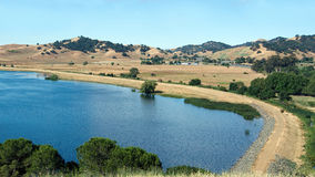 Lagoon Valley Park lake. Panoramic view of the North side of the Lagoon Valley Park lake in Vacaville, California, USA, featuring the chaparral in the summer Royalty Free Stock Image