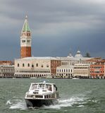 Lagoon of Venice with the bell tower of Saint Mark and boat into Royalty Free Stock Photography