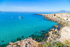 Lagoon with vessels on Favignana island in Sicily Stock Image