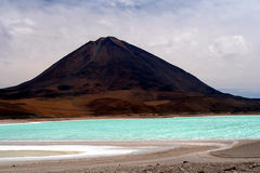 Lagoon And Volcano. Green lagoon - Laguna Verde in southern Bolivia royalty free stock image