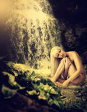 Lagoon, waterfall and sexy blond woman Stock Photo