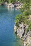 Lagoon Zakrzowek in an old limestone quarry, emerald water, resting people, Krakow, Poland Stock Photography