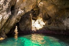 Lagos Caves and Seashore with its Esmerald Water. Exposure done in a boat tour in the Lagos seashore, Algarve, Portugal Royalty Free Stock Photo