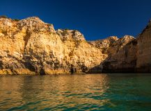 Lagos Caves and Seashore with its Esmerald Water. Exposure done in a boat tour in the Lagos seashore, Algarve, Portugal Royalty Free Stock Image
