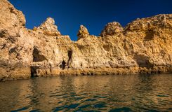 Lagos Caves and Seashore with its Esmerald Water. Exposure done in a boat tour in the Lagos seashore, Algarve, Portugal Stock Photo