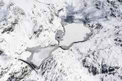 Lagos Gemelli con la nieve y el hielo, Orobie, Italia Imágenes de archivo libres de regalías