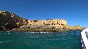 Natural rock formations at the coastline in Praia da Marinha in Algarve region, Lagos, Portugal