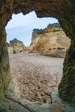 Lagos, Portugal beach scene framed by rock tunnel stock photography