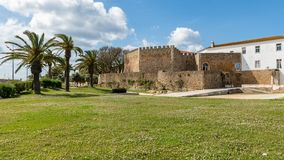 The Governors Castle. LAGOS, PORTUGAL - CIRCA MAY 2018: View of the entrance arch of the Governors Castle Castelo dos Governadores with palm trees in the Royalty Free Stock Photos
