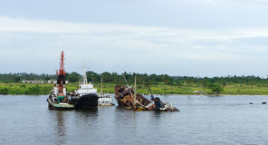 Lagos river. Wreck of old boat in lagos river Stock Photo