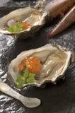 A lagosta e as ostras fecham-se acima Fotografia de Stock Royalty Free