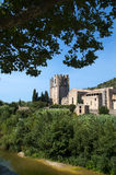 Lagrasse's abbey. Vertical image of Lagrasse's Abbey and the shore of the river Orbieu Stock Images