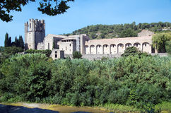 Lagrasse's abbey 2. Landscape image of Lagrasse's Abbey and the shore of the river Orbieu stock photo