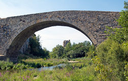 Lagrasse's Old bridge. Belfry of Lagrasse's Abbey through the arch of the old bridge royalty free stock image