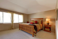 Lagre bedroom with wood bed stock images