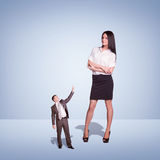 Lagre Young Businesswoman and small Businessman Stock Photography