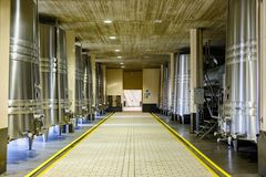 Wineries of La Rioja in Spain. Laguardia, Alava, Spain. April 23, 2018: Room with metal drums for the first fermentation of the wine before passing it to wooden stock image