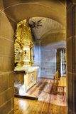 Laguardia, Alava, Spain. March 30, 2018: View Of A Side Chapel Of The Church Of San Juan With A Golden Altarpiece And An Entrance Royalty Free Stock Images