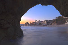 Laguna Beach through the keyhole cave. At Pearl Street Beach at sunset with the water blurred to a glassy look Royalty Free Stock Photography