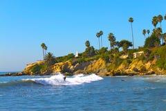 Laguna Beach Surfer. A surfer along the coast in Laguna Beach, California Stock Image