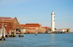 Laguna brick buildings and lighthouse of Murano in Venice in Italy Stock Images