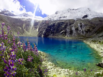 Laguna 69. The Lagoon 69 is in the Huascarán National Park, Ancash department in Peru. This lagoon is at 5800 m.s.n.m. And its spectacular color is because stock images