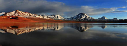 Laguna Lejia. With mirroring of volcanos Lascar and Aguas Calientes (Big Panorama) at sunrise royalty free stock images