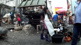 Market Garbage Dump beside fish stall. Laguna, Philippines – July 18, 2015: Garbage dump are collected in the city market site, a measure to sanitize the stock video footage