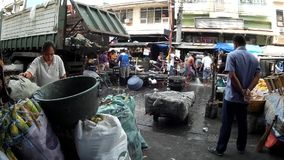 Market Garbage Dump beside food stall. Laguna, Philippines – July 18, 2015: Garbage dump are collected in the city market site, a measure to sanitize the stock video